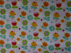 White Cotton Fabrc with Orange/green florals
