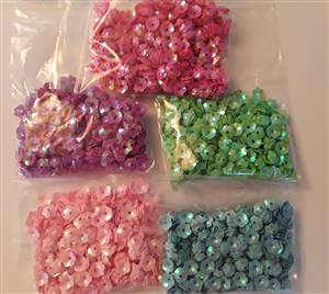 5 bags small plastic flower trimmings